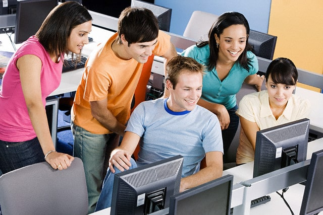 Students in Computer Room --- Image by © Image Source/Corbis